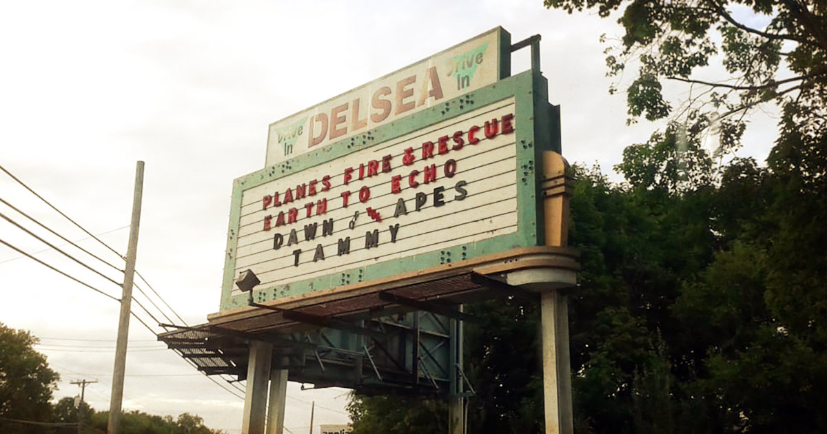 An antique sign showing the movie line ups at Delsea Drive-In Theatre