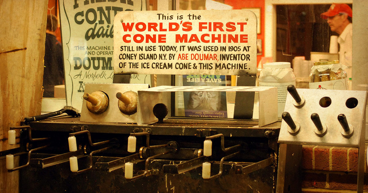 The world's very first ice cream machine with a sign describing its history at Doumar's