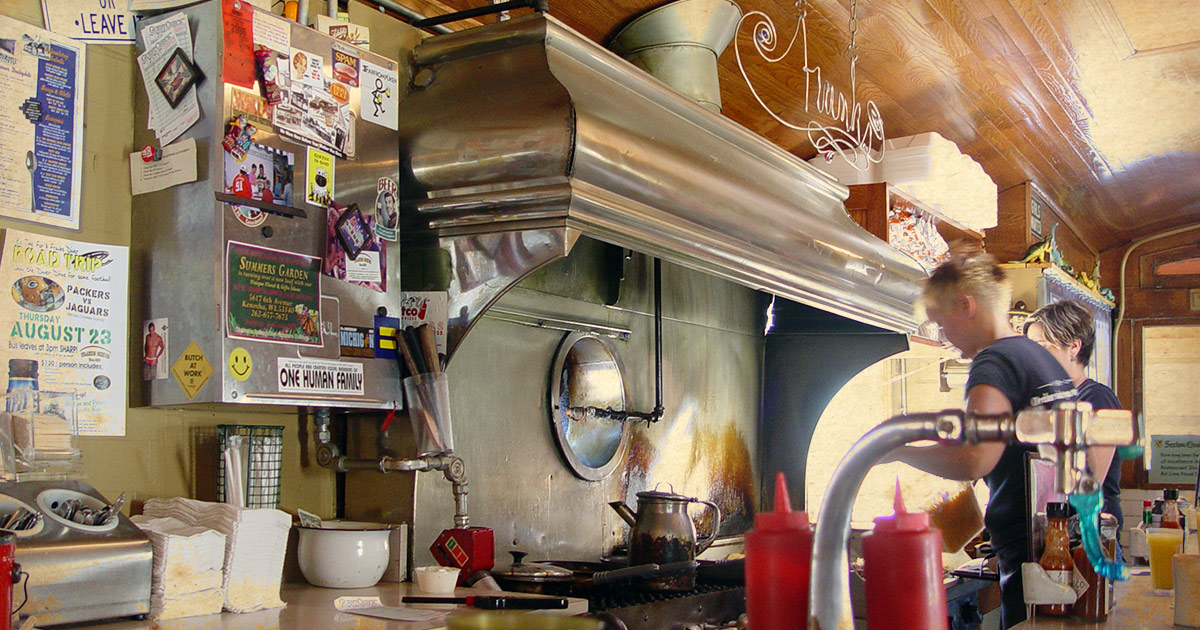 The old-school grill and bar behind the counter at Frank's Diner