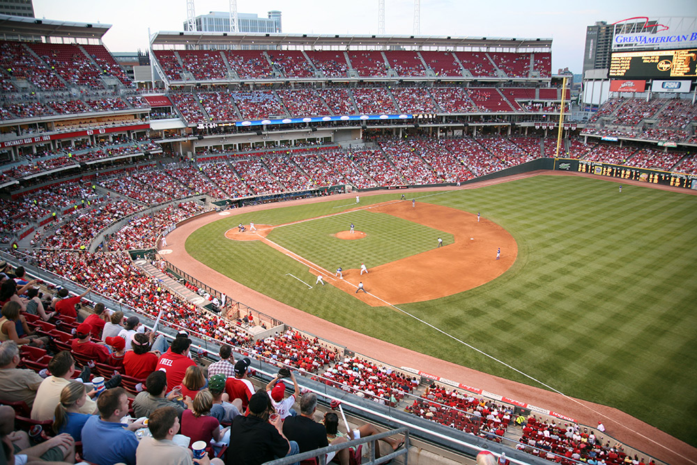 Fans cheering on the Cincinnati Reds at the Great American Ballpark.