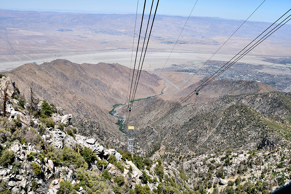 The Palm Springs Aerial Tram with views of the brown and dusty Chino Canyon.