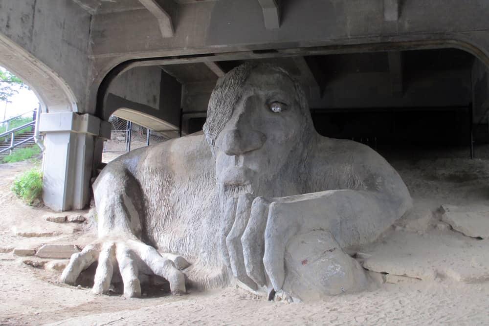 The art installation of the Fremont Troll under the bridge in Seattle, Washington.