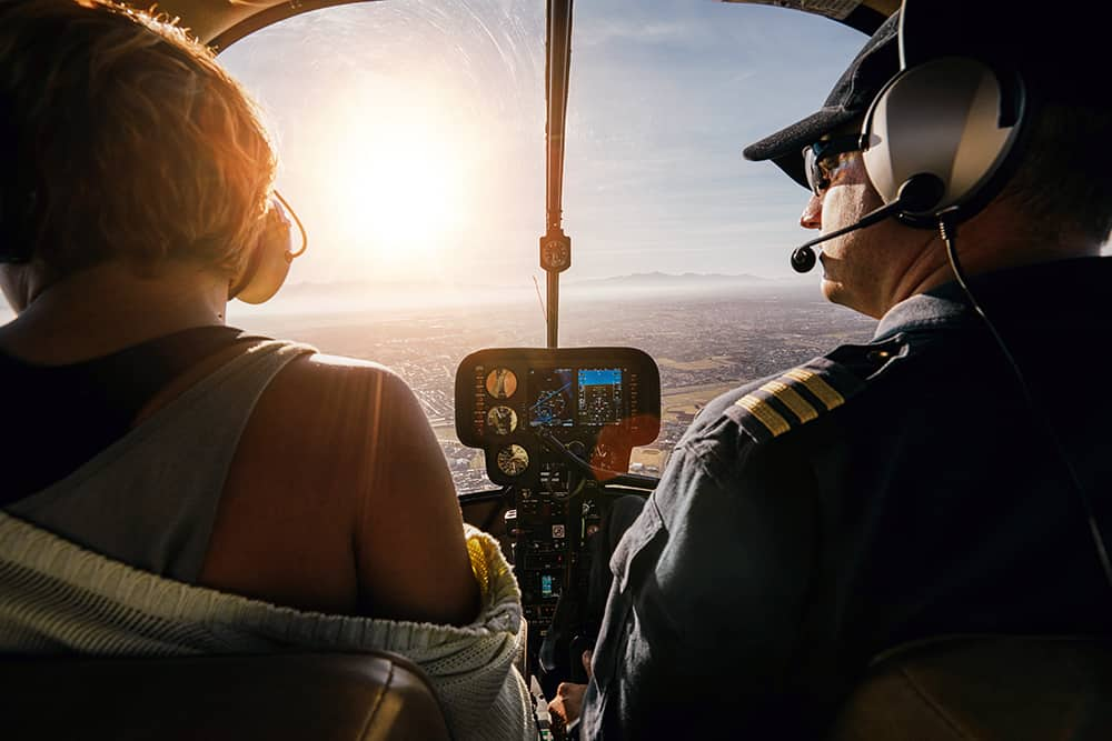 A woman enjoys a helicopter tour