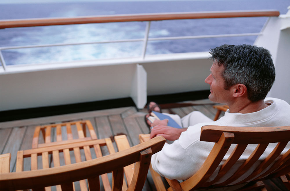 Solo cruise passenger having a relaxing day at sea