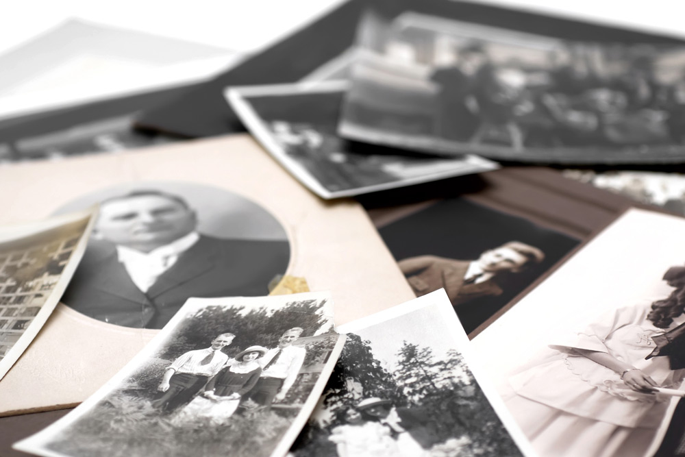 old black and white photos of people on a table