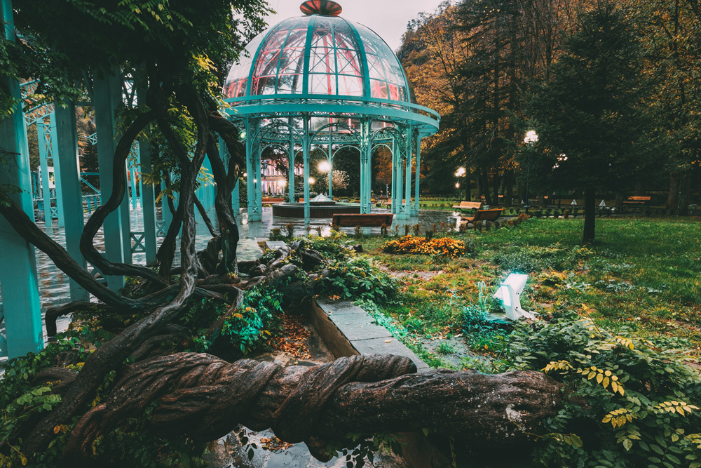 green glass gazebo in a park