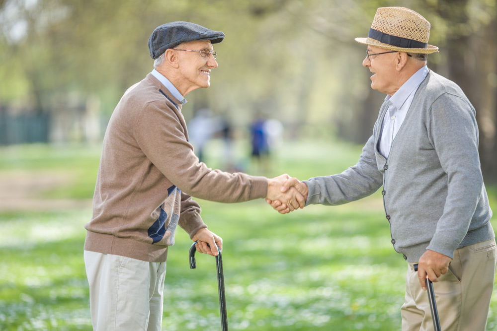 two men shaking hands at a park in germany