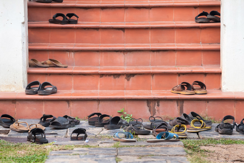 collection of shoes taken off before entering building in japan