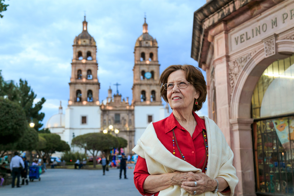 woman standing in from of cathedral in mexico