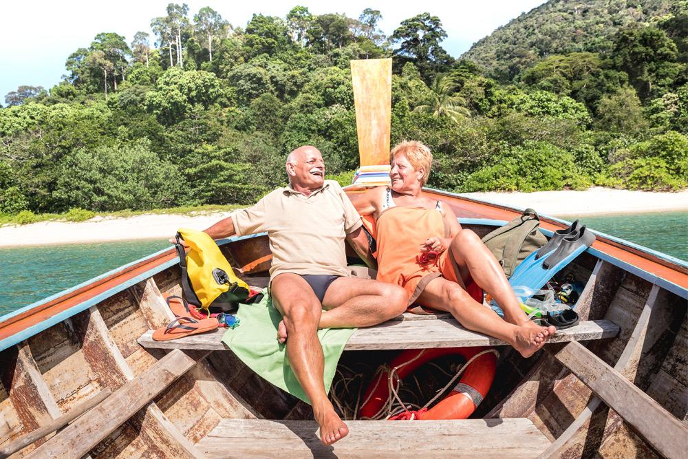 couple on a boat near the beach in thailand