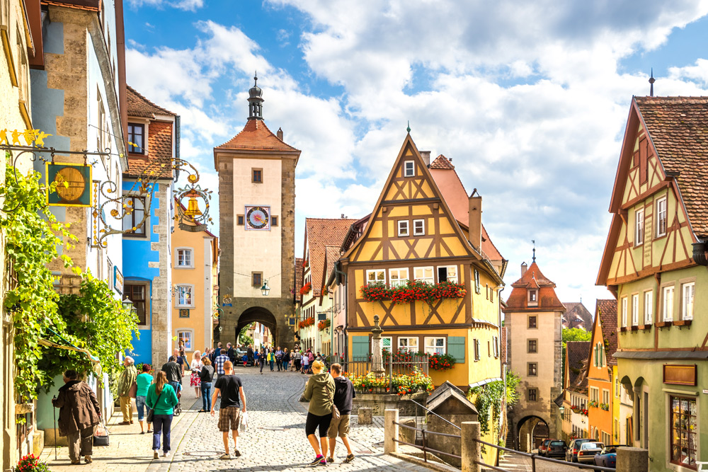 Tourist walking down the Romantic Road in Rothenburg ob der Tauber