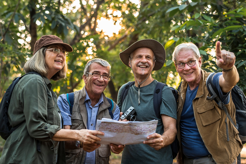 group of friends traveling together holding a map
