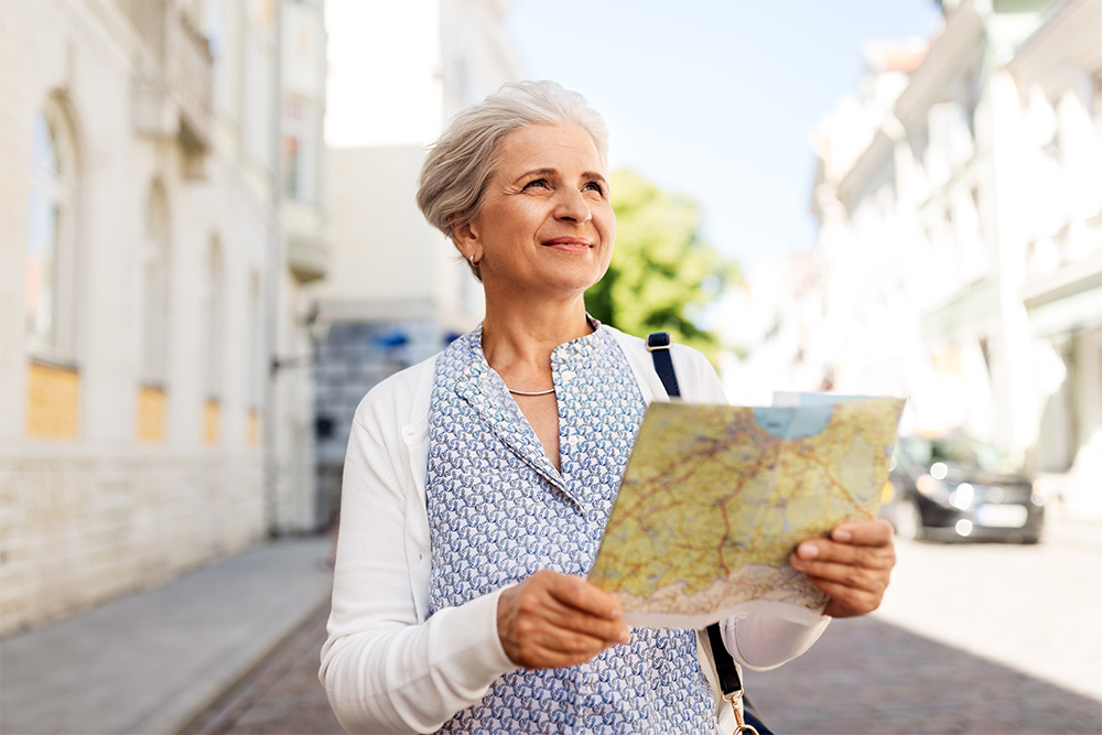 traveling woman holding map