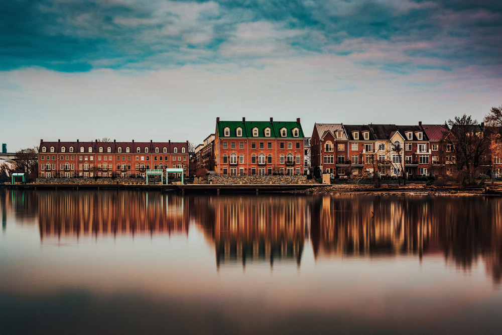 Reflections of waterfront buildings along the Potomac River in Alexandria Virginia