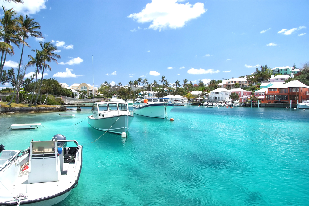 Yacht boats on blue sea water in tropical lagoon in Hamilton, Bermuda.