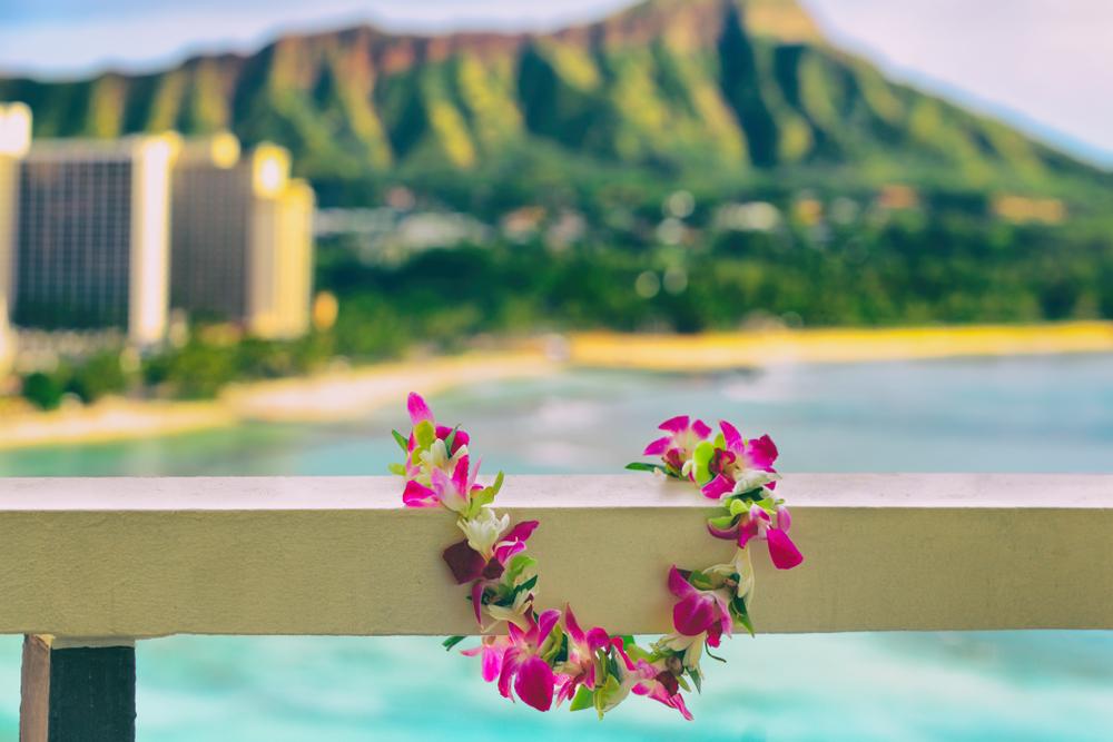 Hawaii background hawaiian flower lei with Waikiki beach landscape