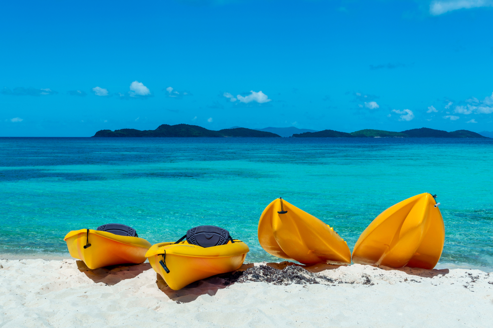 Four Canoes on a beautiful beach in the Caribbean. St. Thomas