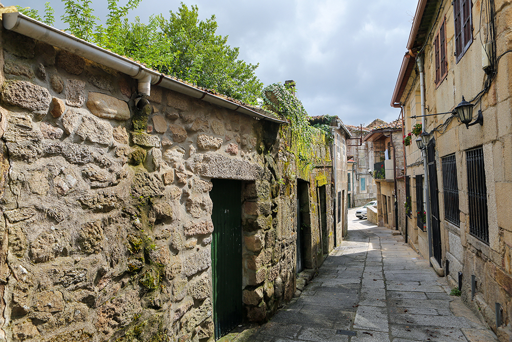 Narrow street in the old center of Tui, a border town with Portugal in the region of Galicia, Spain