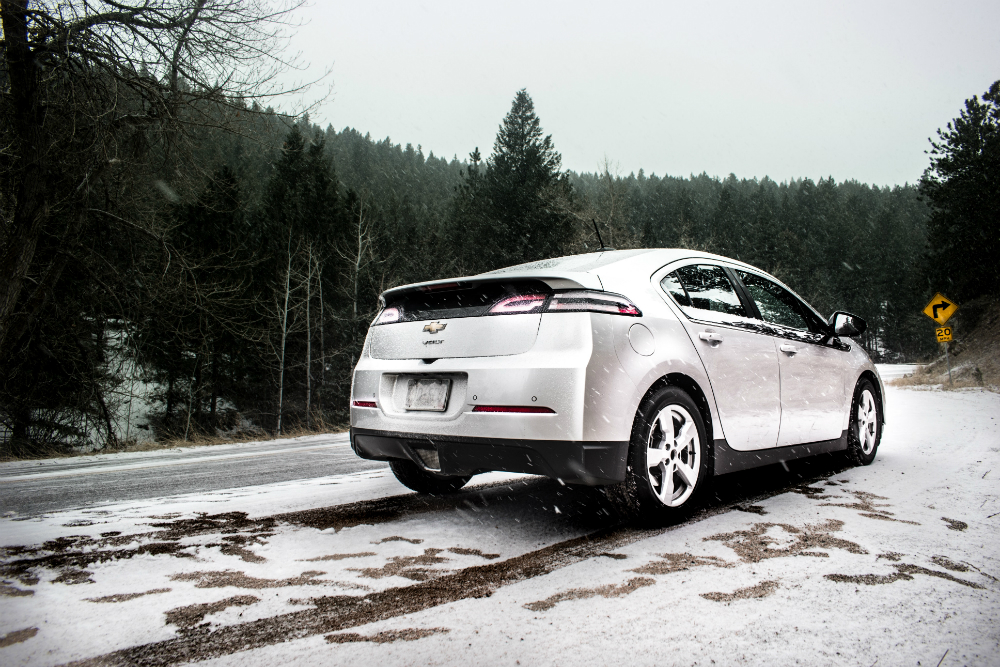 chevy volt driving on icy snowy road in the winter
