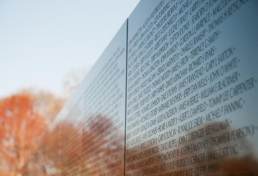 reflection of trees in vietnam veterans war memorial in washington dc