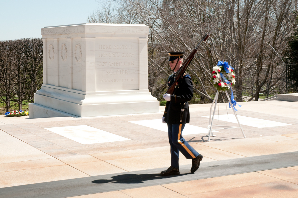 soldier walking in front of the tomb of the unknown soldier