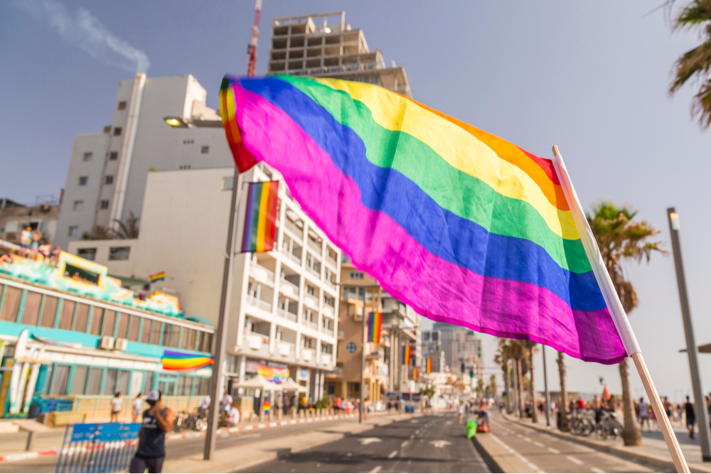 20th annual Tel Aviv Pride Week rainbow flag waving at the beach promenade