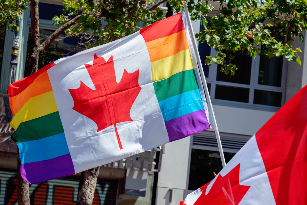 A Canada, LGBT Pride flag waving together during a Pride Festival