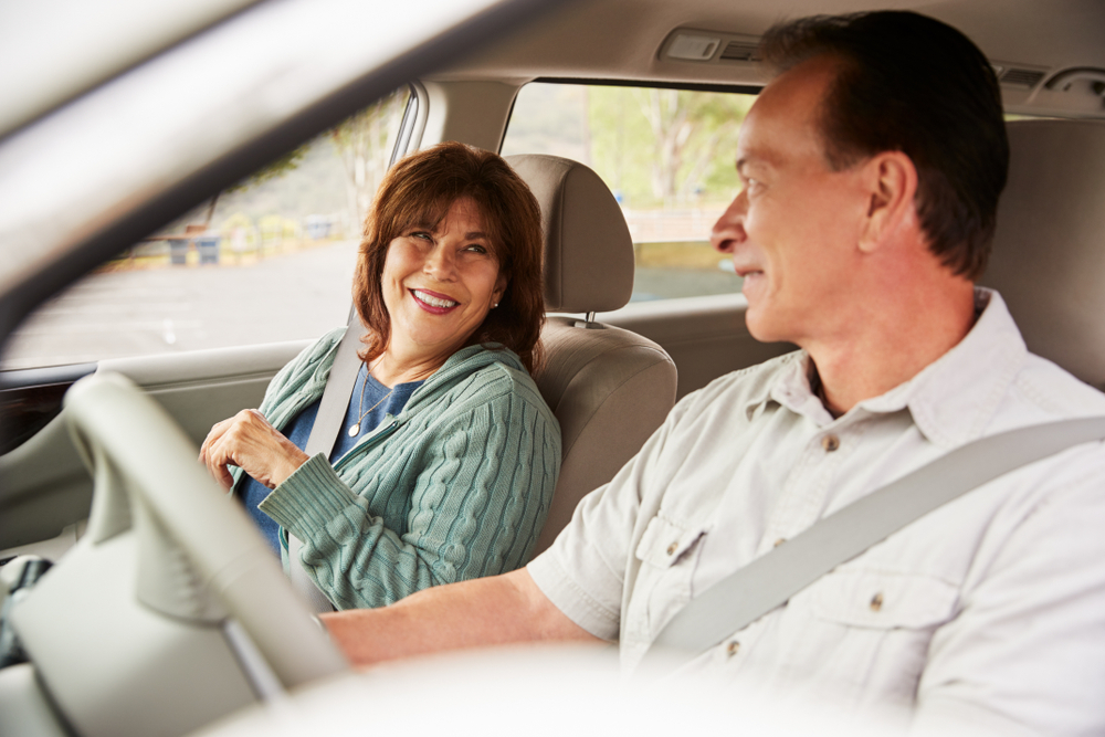 Senior couple in car going on romantic vacation