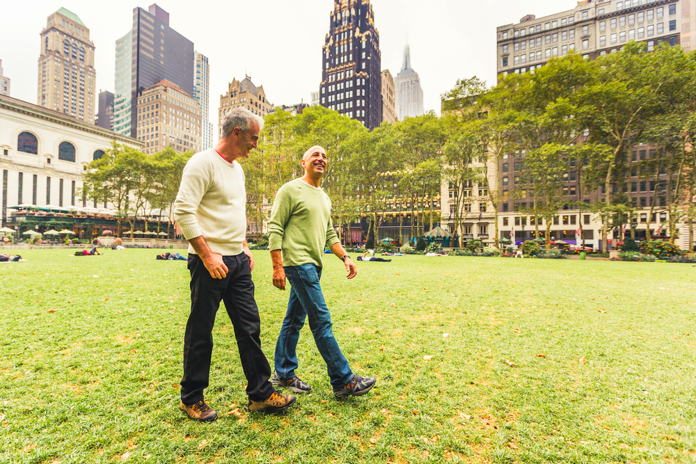 Two senior men having a walk together in New York city