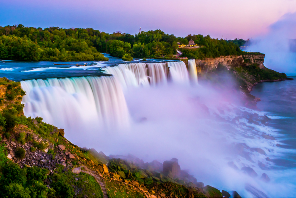 Niagara falls in the summer during beautiful evening, night with clear dark sunset blue sky